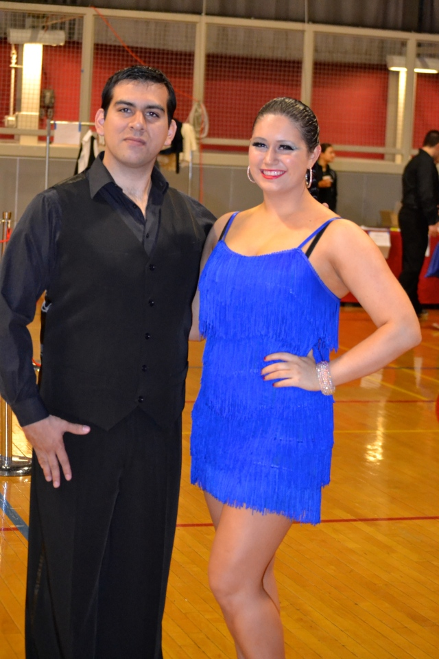 My Peruvian ballroom partner and I at our last competition. After an entire bottle of self tanner, we now have the same complexion.